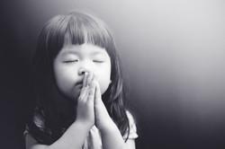 Little girl praying in the night