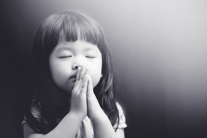 Little girl praying in the night.Little