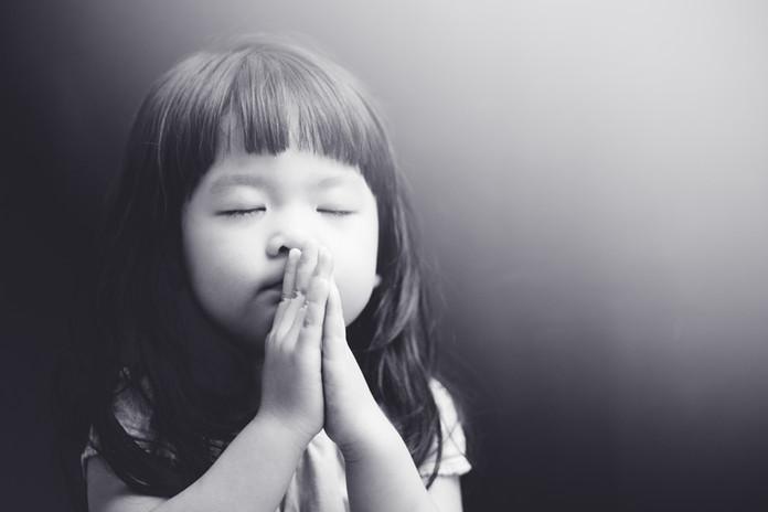Little girl praying in the night.Little