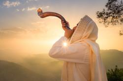 A Jewish man blowing the Shofar (ram's h