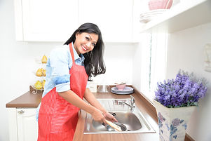 Woman doing the washing up in kitchen_.j