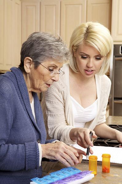 Caregiver helping a senior woman organiz
