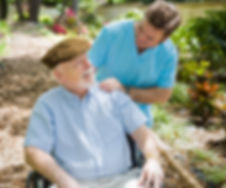 Disabled senior man in the garden with h