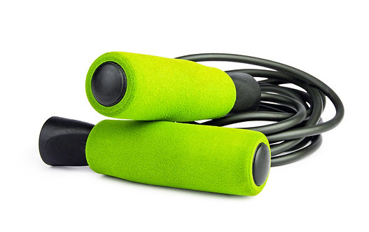 Green jump rope or skipping rope isolate