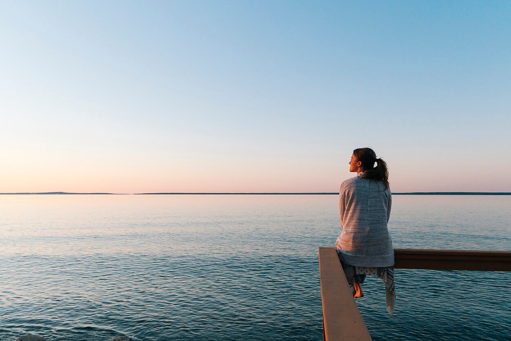 woman looking out onto the water