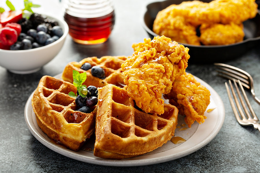 Waffles with fried chicken and maple syrup, southern comfort food.jpg