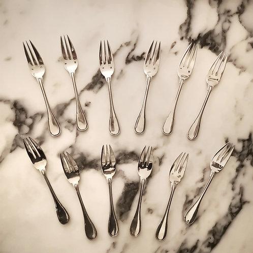 Puiforcat, 12 Fourchettes à gateau en argent massif