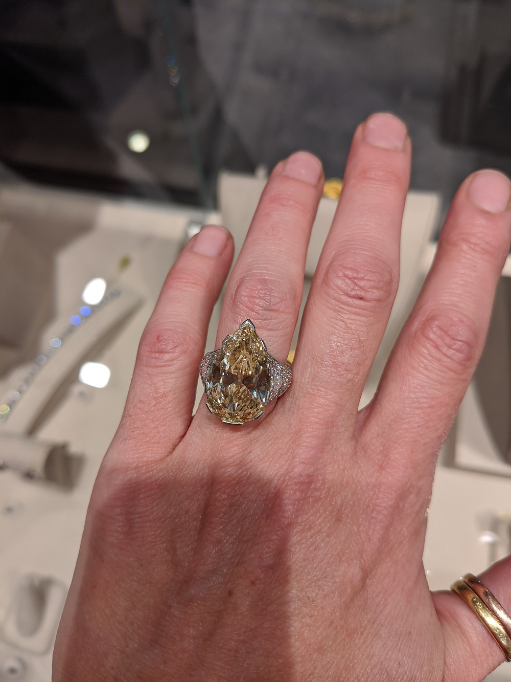 A Fancy Diamond, Diamond and Platinum Ring Sold for $70,000 at auction