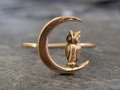 This is a antique 10k pink gold owl perched on a crescent moon conversion ring.