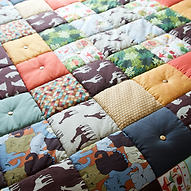 Animal inspired quilted blanket.
