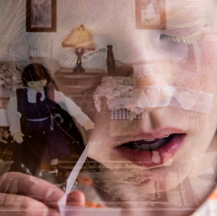 Double exposure of a girl and a television image of a doll house