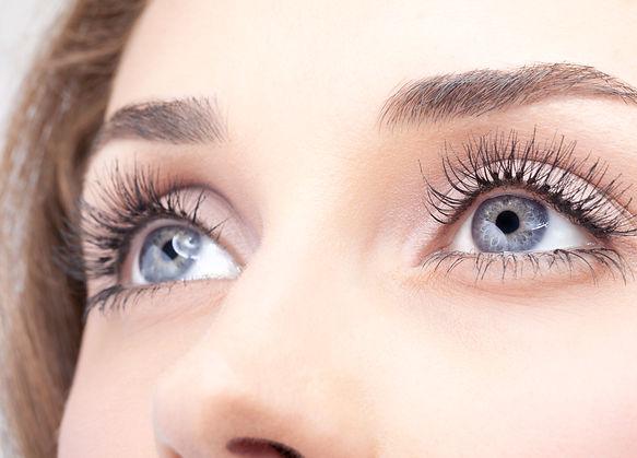 Closeup shot of woman eye with day makeu