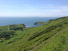 View across Lulworth Cove with Portland in the distance