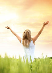 Picture-of-Woman-in-field-with-arms-up-i