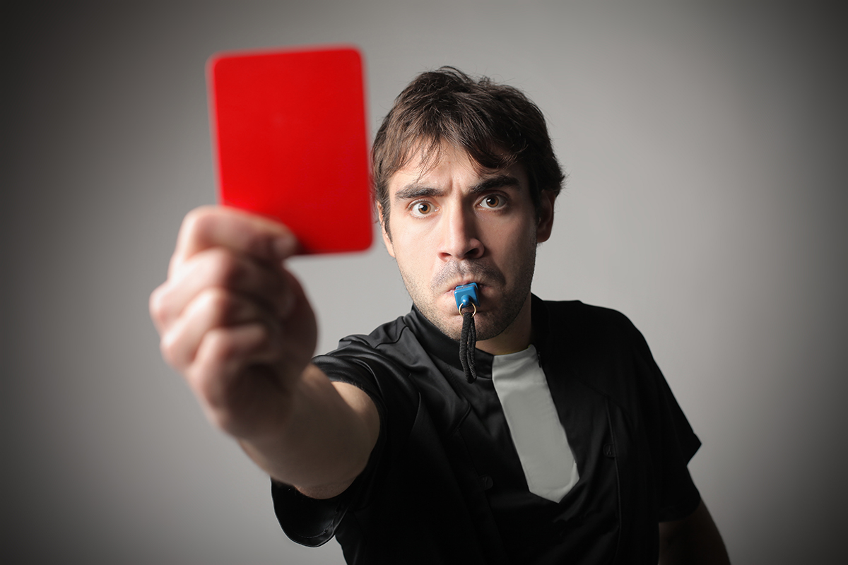 Referree showing red card