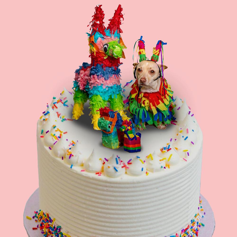 Papas posing on a birthday cake with llama