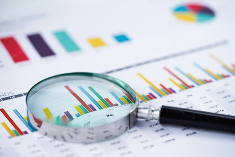 magnifying-glass-charts-graphs-spreadsheet-paper.jpg