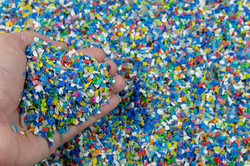 Close-up of plastic polymer granules. hand hold Polymer pellets. polymer plastic