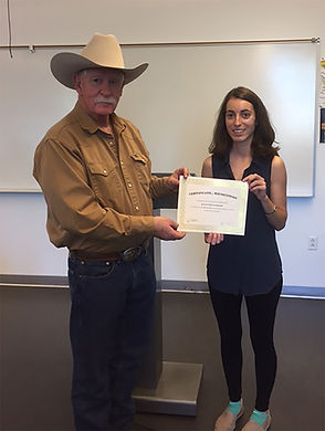 Poet Red Shuttleworth gives certificate to Kat Zamani, a WALL staffer and poetry contest finalist.