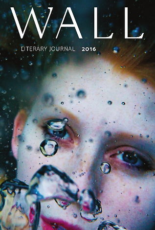 A woman's face floats underwater behind a string of bubbles on the 2016 cover of WALL.