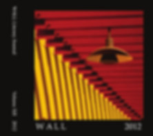 The 2012 cover of WALL features an orange lamp dangling from bright red and yellow walls.