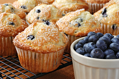 Freshly Baked Blueberry Muffins and a bowlof fresh blueberries