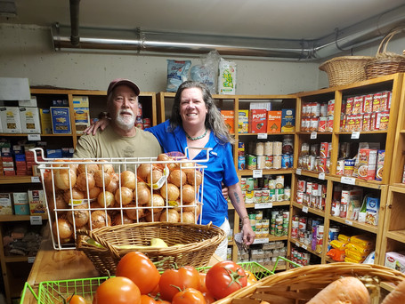 Volunteers Dan and Audrey are pleased to offer an abundance of fresh veggies.
