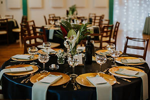 Blue and gold table setting for a corporate event