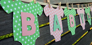 Green and pink polka dot baby onesie sign