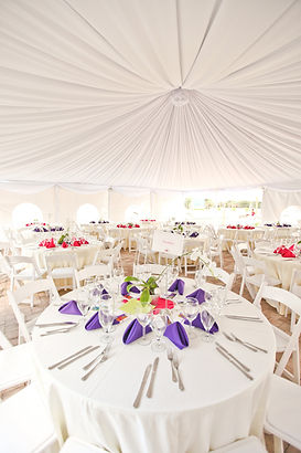 Reception tables under a tent for Grandma's Place Charity event