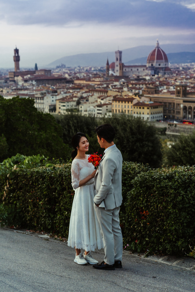 Bride and groom standing front to front at Florence, Italy