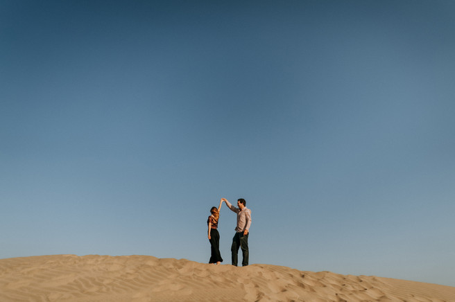 Man and woman dancing in the desert