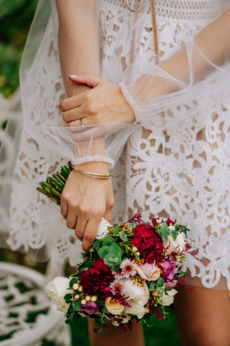 Bride's arms and bouquet