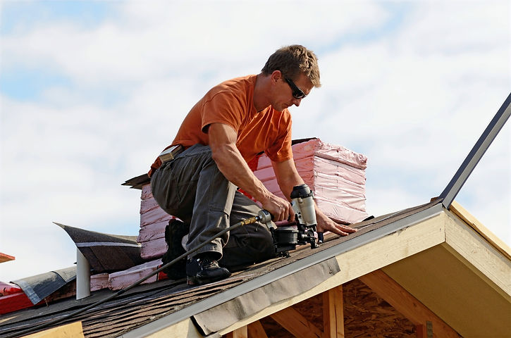 Fixing%20the%20Roof_edited.jpg
