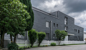 Neubau Naturschiefer Fassade Lachenstrasse