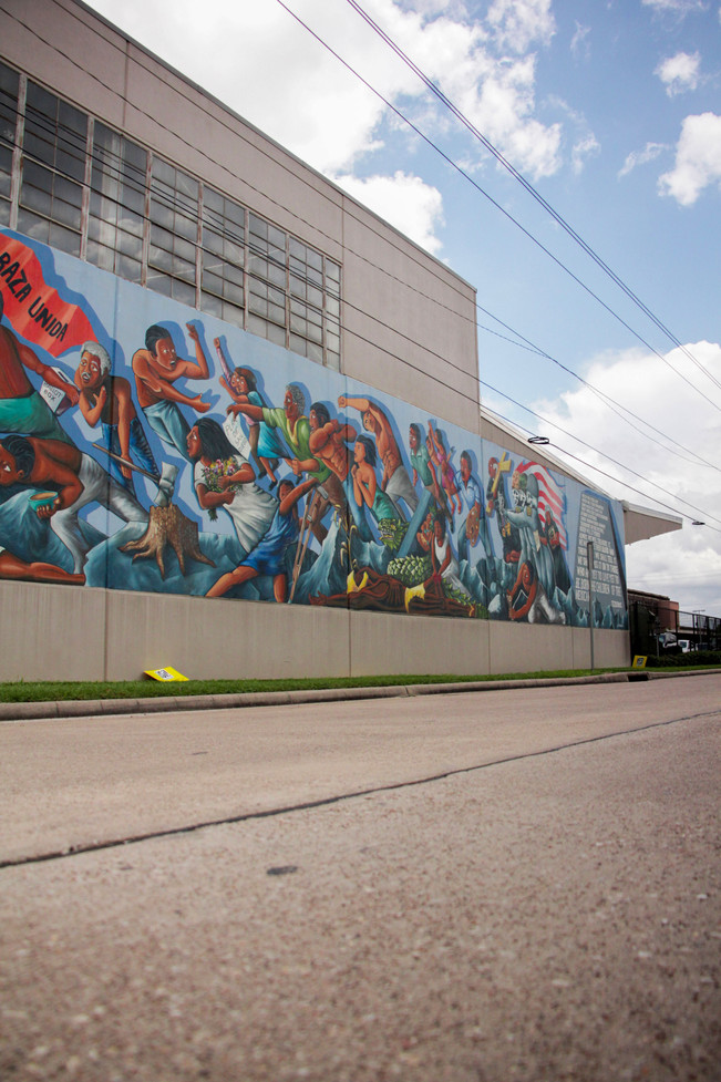 Low angle shows the importance of the mural. It represents the struggles of the hispanic community throughout history.