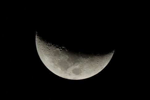 Moon through telescope.jpg
