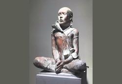 Statue OmidUn Marchand, Un Artiste 2