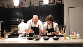 Chef Jacob Bickelhaupt and Chef Katy preparing a meal as personal chefs