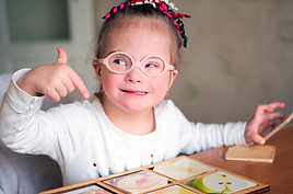 special needs girl student learning at What's Cookin'
