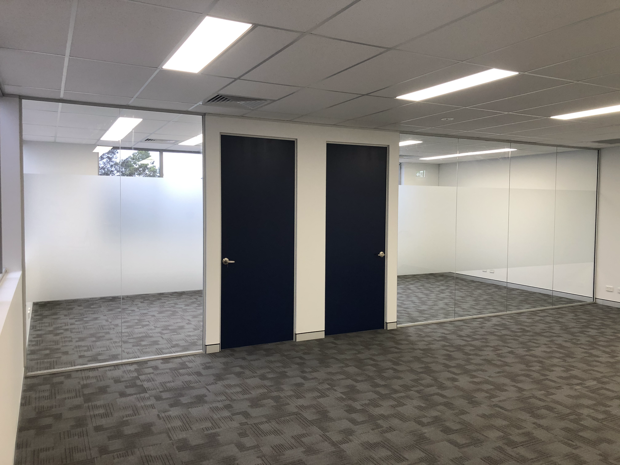 Office Glass Partition Installed with frosted privacy film