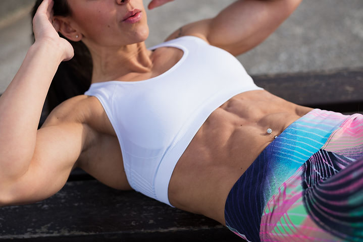 Fitness Woman Doing Crunches Outside.jpg