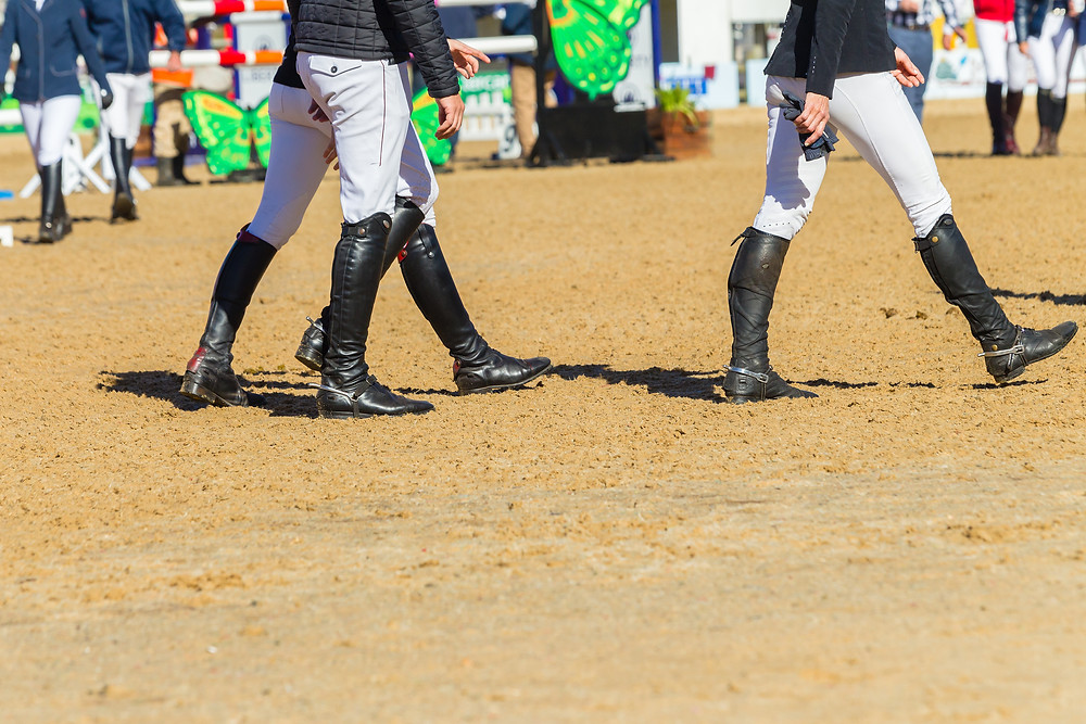 Equestrian riders walking the course