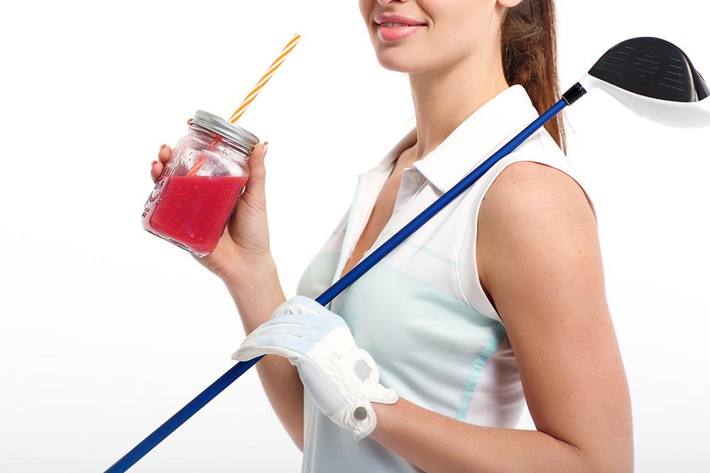 Golfer drinking fruit smoothie