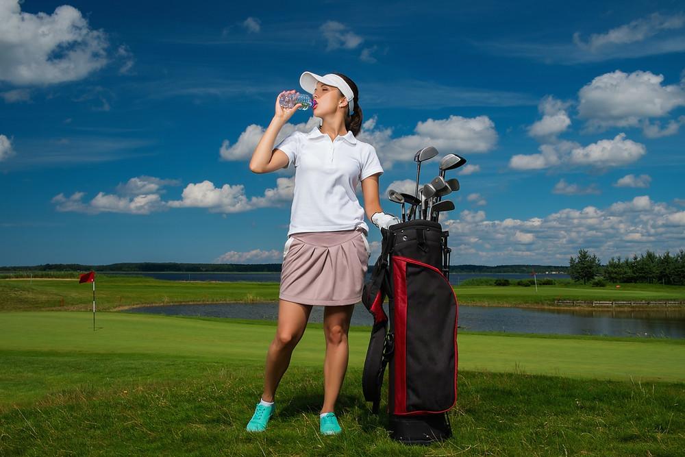 Golfer drinking water