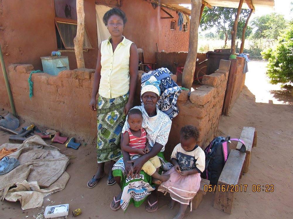 Mayrub (standing) with Grandmother, children.