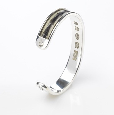 The Burnished Horse Inlaid Woven Torque Bangle