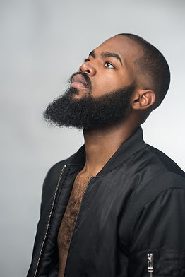 A portrait of a bearded young african ma