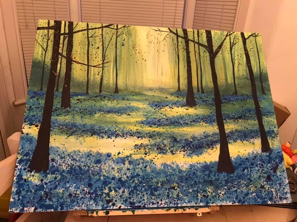 Woodland walk through bluebells