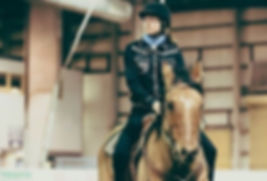 A girl rides her horse in a Cowboy Dressage Competition.